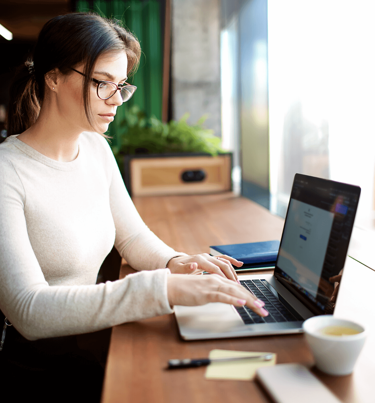 Woman at desk email automation